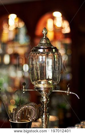 Barman equipment on bar.Absinthe Fountain.Second plan defocussed.Bokeh
