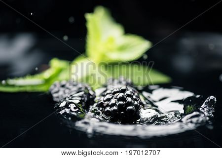 Ripe Blackberries Falling In Water