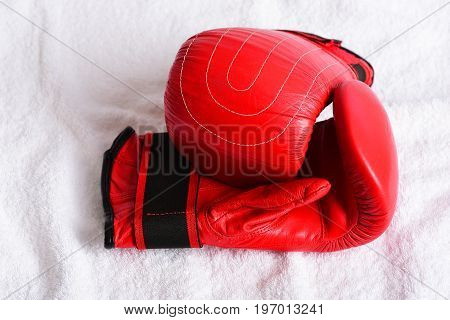 Couple Of Red Mittens For Boxing Lying On Each Other