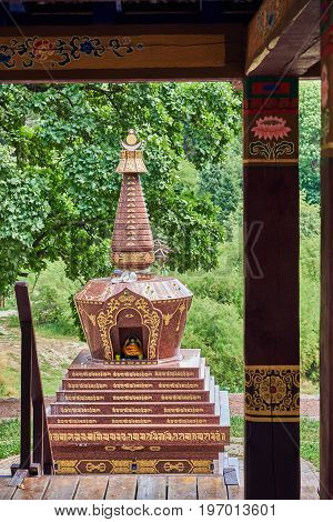 View of the Buddhist Stupa from the arbor for meditations. The site of the Tibetan culture and nature in the National Botanical Garden (Kiev Ukraine)