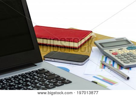 close up business accessories laptop calculator datasheet pen notebook and smartphone on desk isolated on white background financial report saving and economy business concept selective focus