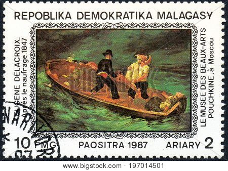 UKRAINE - CIRCA 2017: A postage stamp printed in Madagascar shows Eugene Delacroix: After the Shipwreck 1847 from series Paintings from Pushkin-Museum Moscow circa 1987
