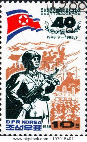 UKRAINE - CIRCA 2017: A postage stamp printed in North Korea shows Paektu mountain guerilla fighter from series The 40th Anniversary of Democratic Republic of Korea circa 1988