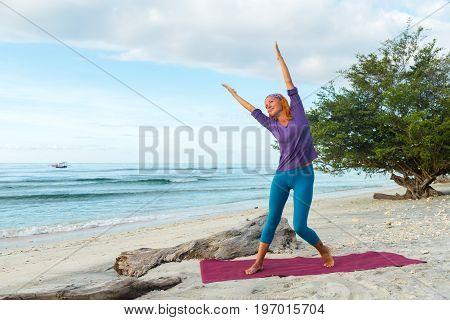 Young woman practicing yoga at exotic Bali location