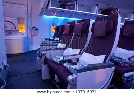 DOHA, QATAR - CIRCA MAY, 2017: inside Qatar Airways Boeing 777. Qatar Airways, is the state-owned flag carrier of Qatar.