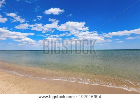 Summer scene on sea with clouds in blue sky
