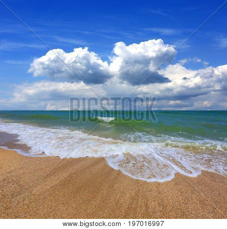Summer scene on sea with clouds in sky