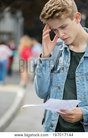 Portrait Of Teenage Boy Disappointed With Exam Results