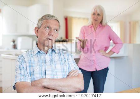 Unhappy Senior Couple Having Argument At Home