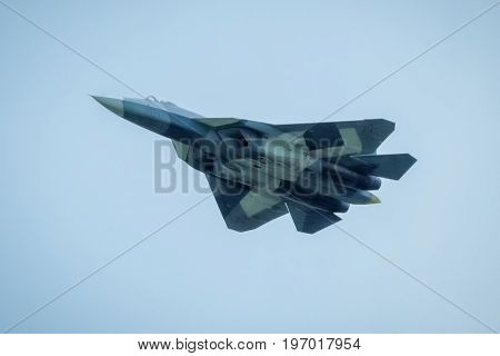 Moscow Region - July 21, 2017: New Russian fifth-generation fighter T-50 (Sukhoi PAK FA) flies in the rain at the International Aviation and Space Salon (MAKS) in Zhukovsky.