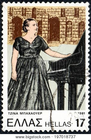 UKRAINE - CIRCA 2017: A postage stamp printed in Greece shows Gina Bachauer 1913-1976 Greek classical pianist from series Anniversaries and Events circa 1981