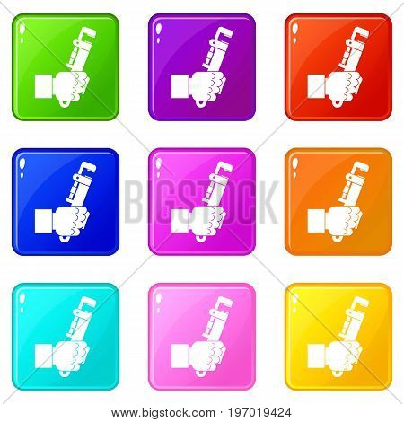Hacksaw in man hand icons of 9 color set isolated vector illustration