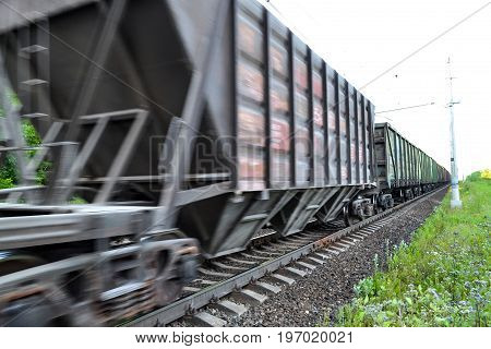 Freight train railway wagons with motion blur effect. Transportation railroad.
