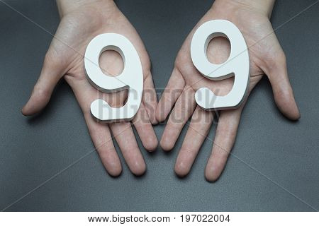 To Female Hands The Number Ninety-nine.
