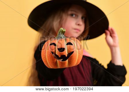 Kid In Black Witch Hat And Dress. Halloween Party Concept