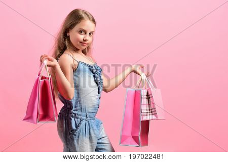 School Girl With Packages Isolated On Pink Background