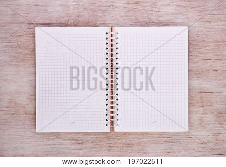 Open Notebook On Wooden Table