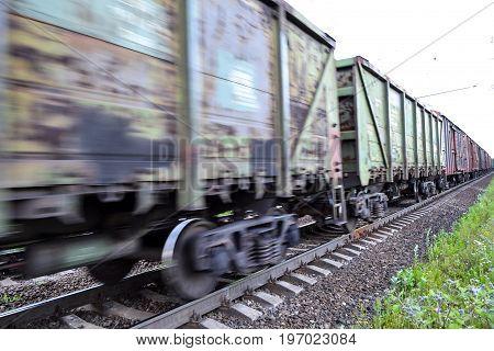 Freight train railway wagons with motion blur effect. Transportation railroad.