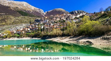 Beautiful lakes of Italy- turquoise Lago di Barrea and medieval village ,Abruzzo