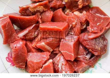 Closeup pieces of raw meat ready for cooking