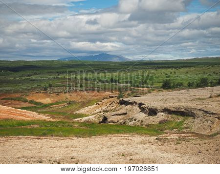 Iceland Northern Landscape With Green Vegetation And Puffy Clouds