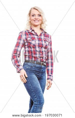 Middle aged blonde attractive woman wearing jeans pants plaid shirt posing studio shot