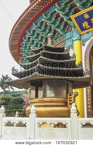 Close up of Gold Incense burner in the Tianyuan TempleTaiwan