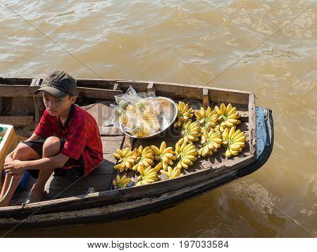 MEKONG DELTA, VIETNAM - April 25, 2014 - Fruits vendor at Asian floating market on Mekong river in Vietnam