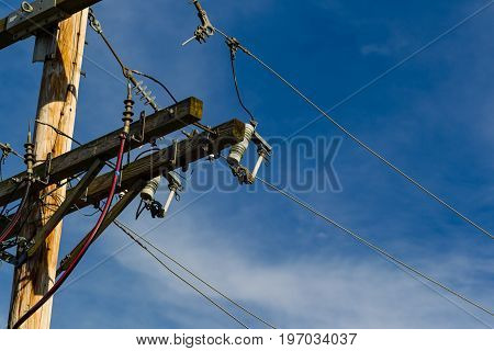 a utility pole with some of the wires an connections