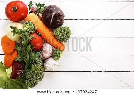 Most useful vegetables are broccoli, onions, garlic, tomatoes, carrots. View from above, a great place for text