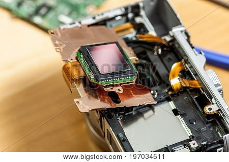 Camera inside parts of sensor matrix close up. Fixing technology modern device.