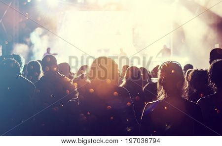 Crowd at concert and colorful stage lights, music festival