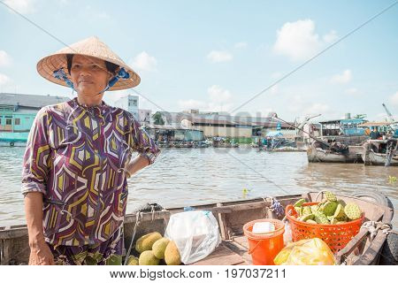 MEKONG DELTA, VIETNAM - April 25, 2014 - Food vendor at Asian floating market on Mekong river in Vietnam