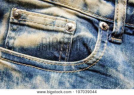 Wrinkled blue jeans texture.Jeans background is beautiful
