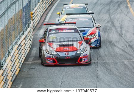 Bang Saen Thailand - July 1 2017: WS Lai Malaysia Tin Sritrai Thailand and S. Thong Hong Kong fighting for positions during TCR Asia Series at Bang Saen Street Circuit in Bang Saen Thailand.