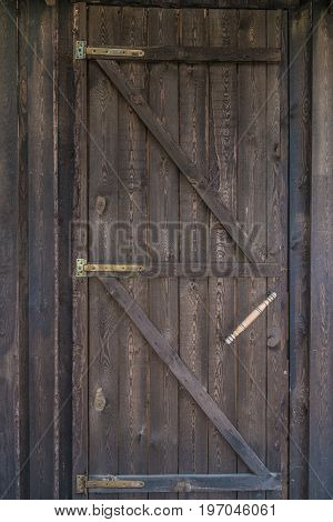 Countryside aged old farm barn door closeup view