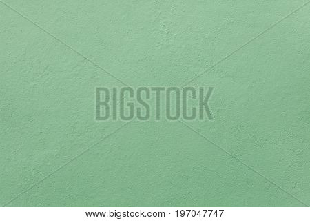Green painted stucco wall. Background texture.