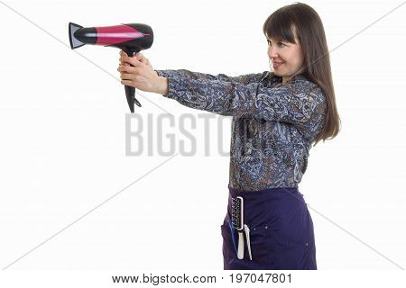 Cheerful adult woman stylist with hairdryer in hands smiles isolated on white background