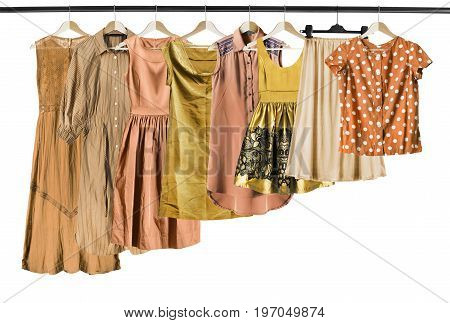 Yellow woman clothes on clothes racks isolated over white