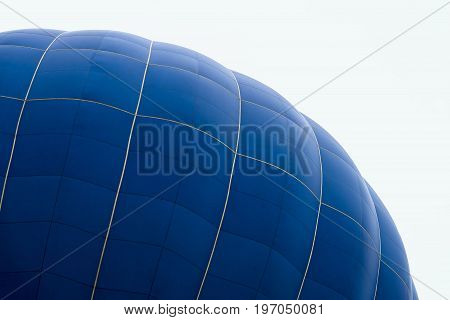Hemispherical upper part of a huge balloon close-up. Modern background for bright moments of life, risk and adventure.