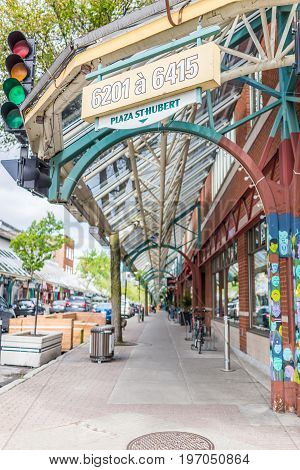 Montreal, Canada - May 27, 2017: St Hubert Street Covered Sidewalk With Shops And Restaurants In Pla