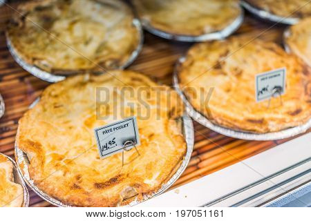 Chicken Pate Meat Pies On Display With Signs In French In Bakery