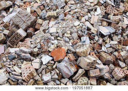 Broken bricks and concrete blocks. Construction debris.