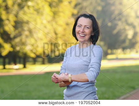 Portrait Of Mature Woman Cheking The Pulse After Jog In The Park