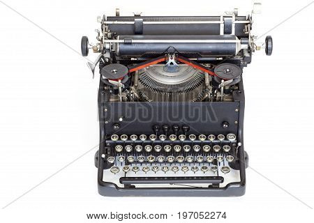Portable old vintage typewriter isolated over white background
