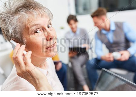 Woman as senior businesswoman gets message on smartphone