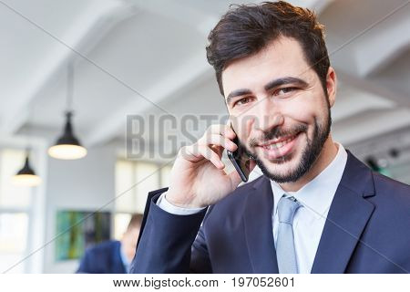 Man as business start-up founder calling with smartphone