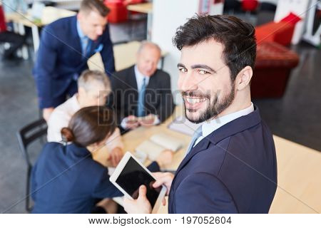 Start-up man as successful consultant founder in business meeting