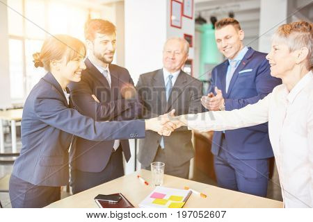 Business people shake hands as business agreement sign