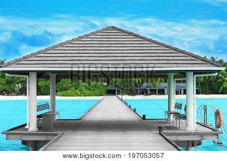 Shelter shed and wooden pontoon at tropical resort on summer day